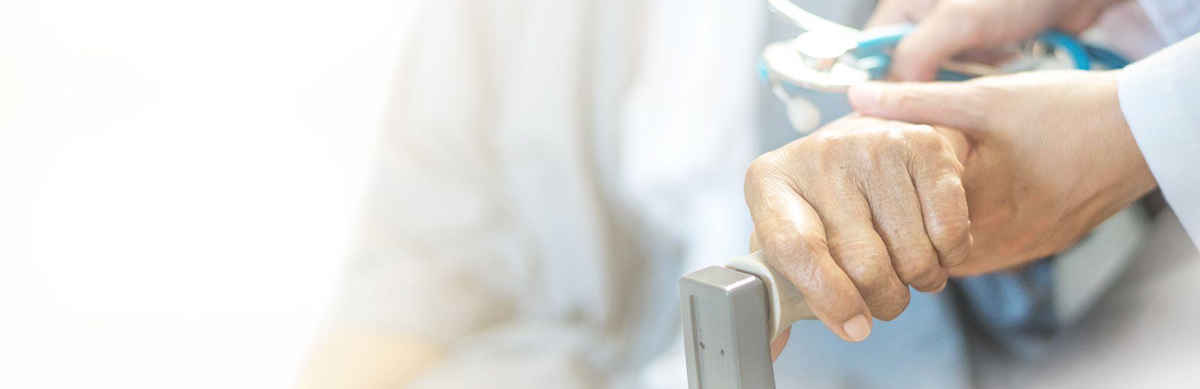 elderly-patient-beig-helped-by-doctor